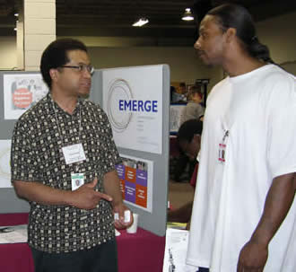 An offender receives employment information from an EMERGE representative